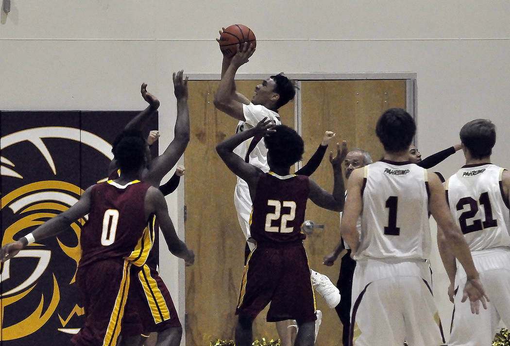 Horace Langford Jr./Pahrump Valley Times Antonio Fortin of the Pahrump Valley Trojans is seen preparing to shoot the ball against Del Sol. The Trojan boys will play their next home game on Monday, ...