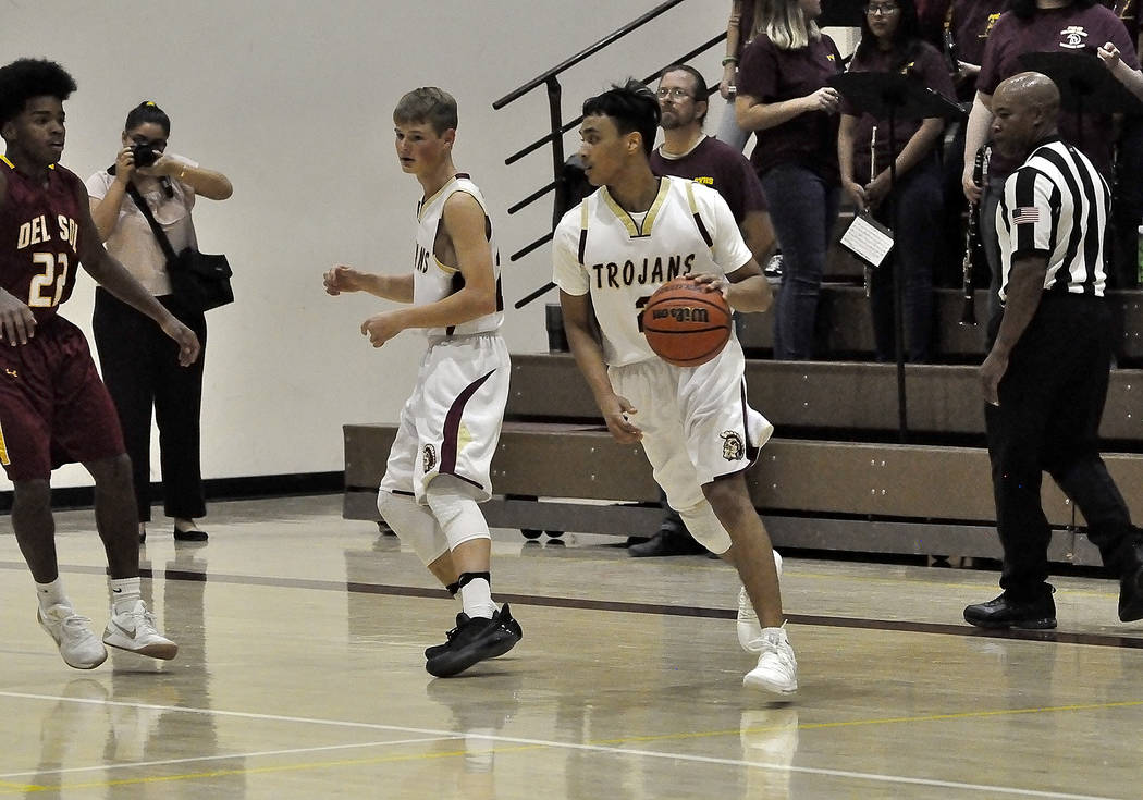 Horace Langford Jr./Pahrump Valley Times Pahrump Valley High School basketball player Antonio Fortin is shown in action against Del Sol. The Trojans next game comes today against SLAM Academy.