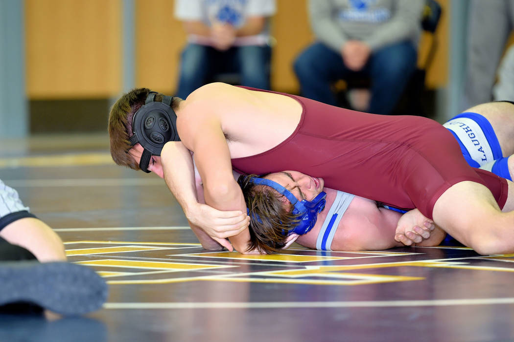 Peter Davis/Special to the Pahrump Valley Times Pahrump Valley's Tristan Maughan is shown pinning an opponent this season. Recently, the Trojan wrestlers traveled to Spring Valley High School to c ...