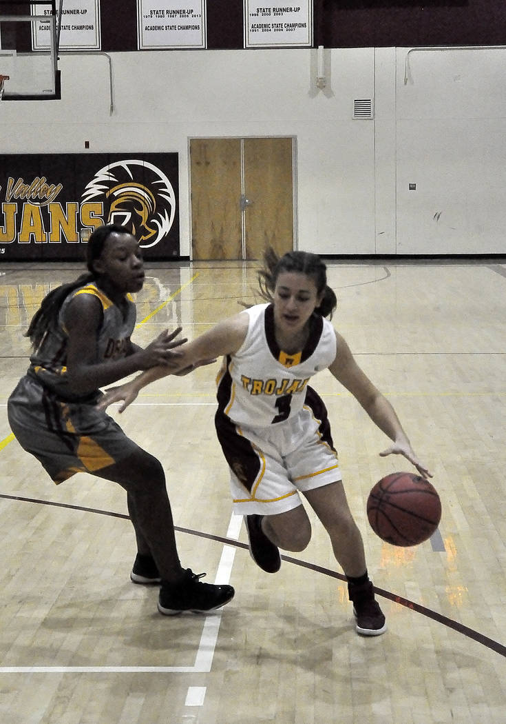 Horace Langford Jr./Pahrump Valley Times  Pahrump Valley's Virginia Weir is shown with the ball in a game earlier this season.The Trojans next game will be against Wells High School in the Lady Bu ...