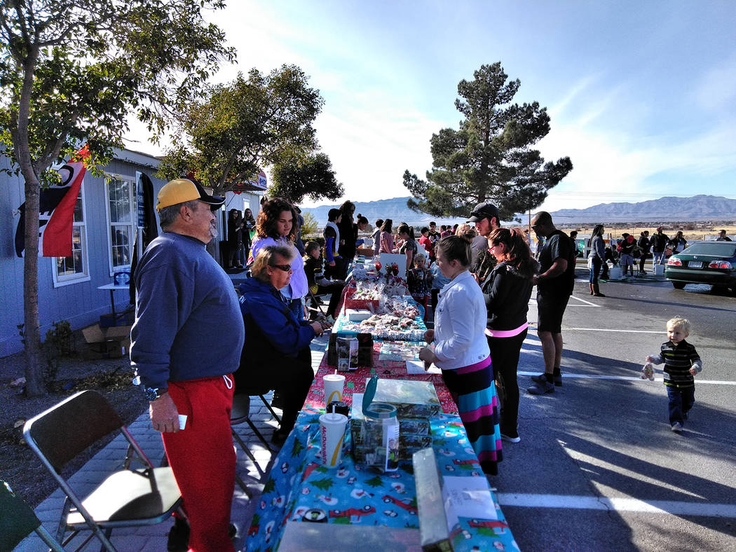 Selwyn Harris/Pahrump Valley Times There were plenty of homemade treats to purchase during the bake sale portion of Sunday's car wash fundraiser. Scores of area residents descended upon 'The Other ...