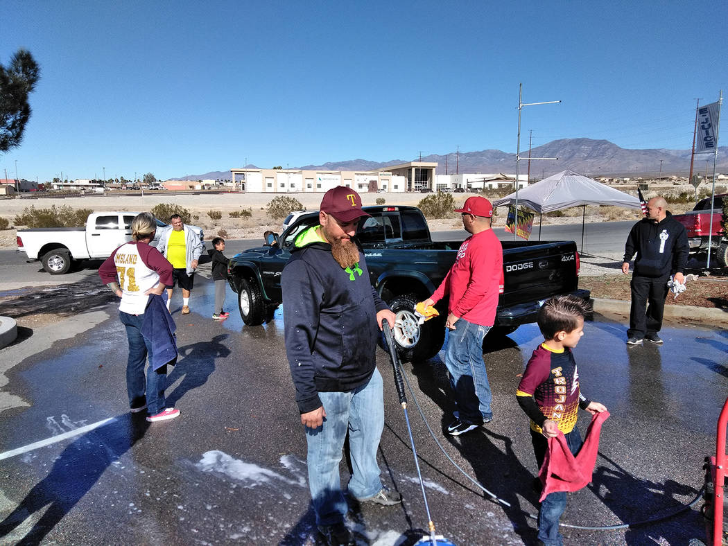 Selwyn Harris/Pahrump Valley Times  Pahrump Youth Sports Founder Johnny O'Neal prepares for another vehicle to wash during Sunday's fundraiser for Nathaniel Bautista-Cleveland and Chase Otteso ...