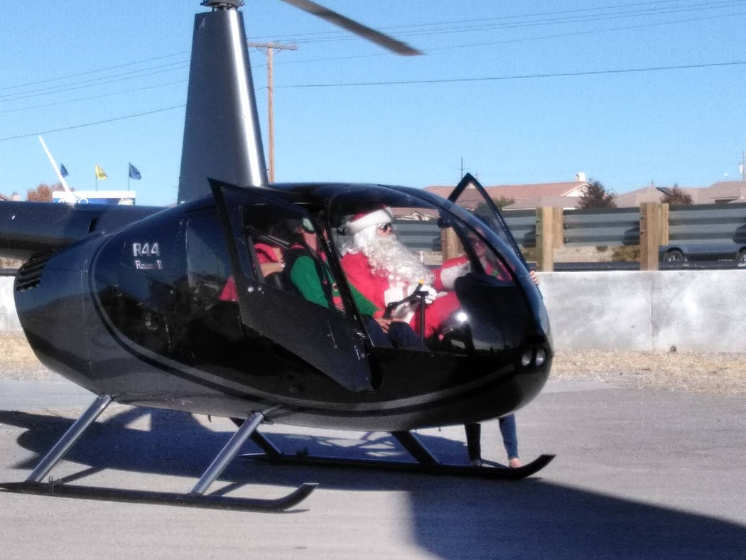 Selwyn Harris/Pahrump Valley Times  Santa Claus arrives at the 'Magic Kingdom' via helicopter late Sunday morning. The brand new local business located at the corner of Homestead Road and High ...