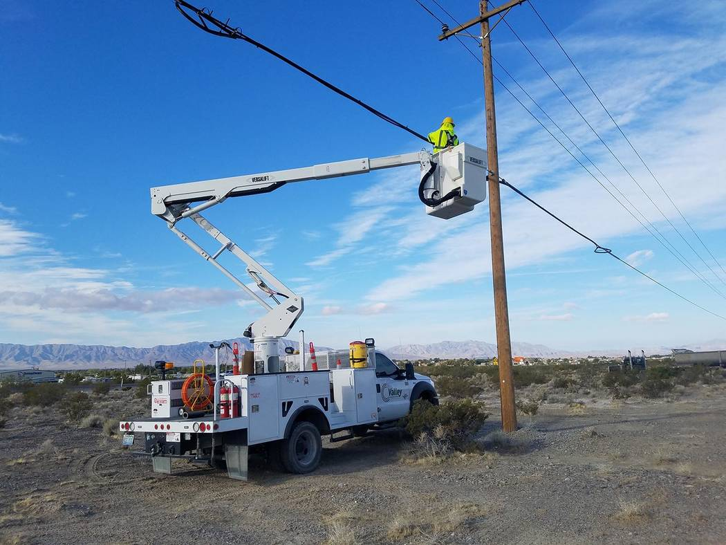 David Jacobs/Pahrump Valley Times Valley Communications Association plans to hang fiber on its power poles from the Sandy Valley turnoff on Nevada Highway 160 to Sandy Valley. In this photo, a cre ...