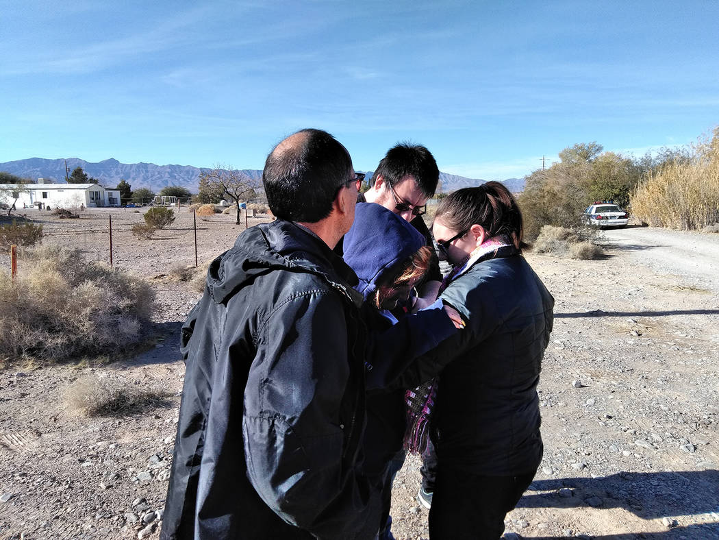Selwyn Harris/Pahrump Valley Times  Family members come together to console local resident Donna Cordova after a house fire killed her 93 year-old father and destroyed her southend home late Sunda ...