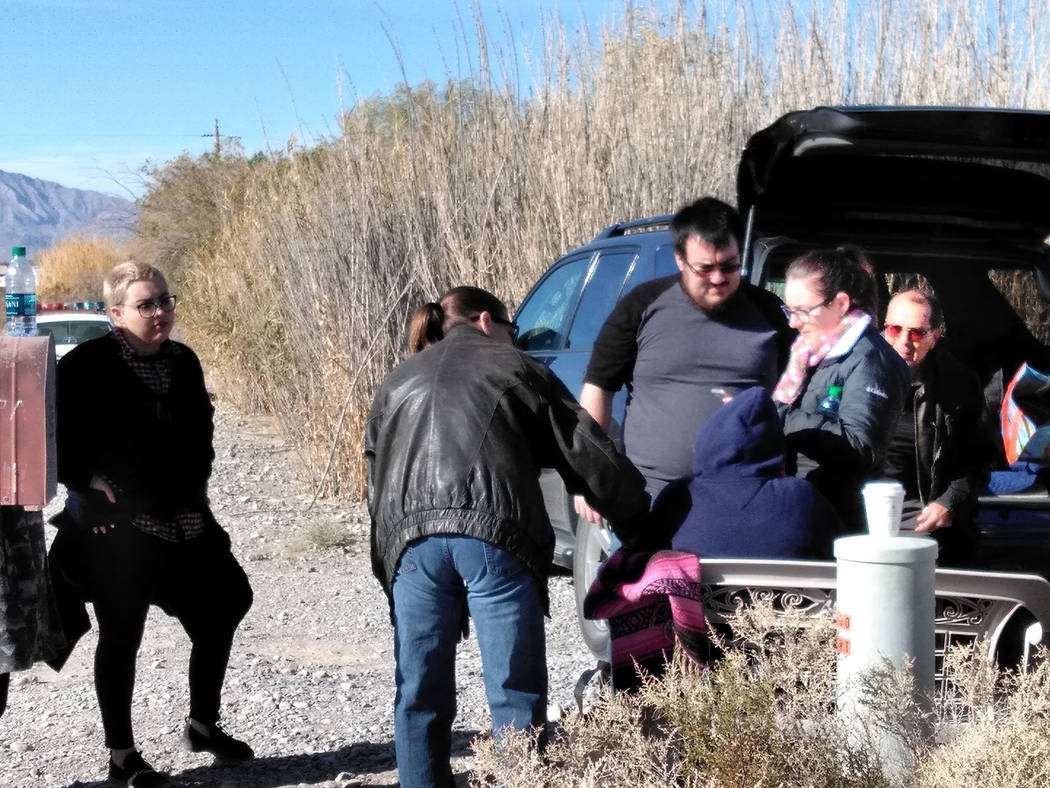 Selwyn Harris/Pahrump Valley Times  A nearby resident Tammy Thompson, offers support to Donna Cordova and her family on Monday morning. Pastor Teresa Sawtelle of Spirit of Love Church said any don ...