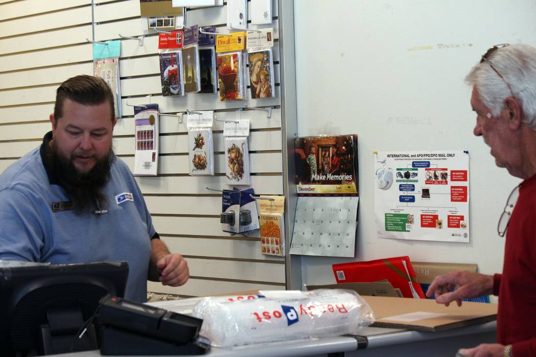 Jeffrey Meehan/Pahrump Valley Times Pahrump citizens ready for shipping gifts during the holiday season. Deadlines are winding down to get packages out. Friday is the latest at the Postal Service, ...