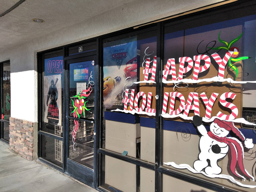 "Selwyn Harris/Pahrump Valley Times  The holiday artwork of Douglas ""Dok"" Hembree can be found on many area retailers around the Pahrump Valley, including the Star Lite Video location along Hig ..."