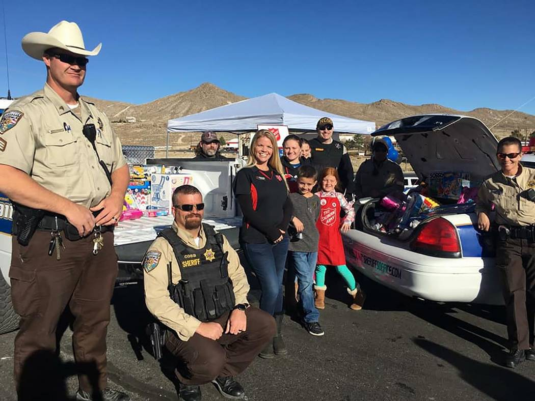 Special to the Pahrump Valley Times Some families make a point to show their children that helping others is also part of the holiday season, columnist Tim Burke writes. Here is a look at a toy dr ...