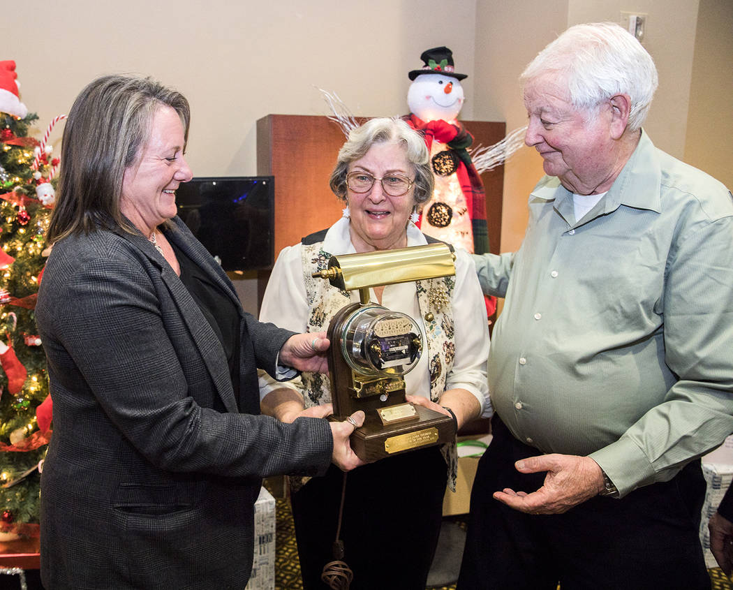 Special to the Pahrump Valley Times Kathie McKenna presents to Kenneth and Janet Thomas, the 2017 Ambassadors of the year award. VEA Ambassadors help to shape the company's future, as well as im ...