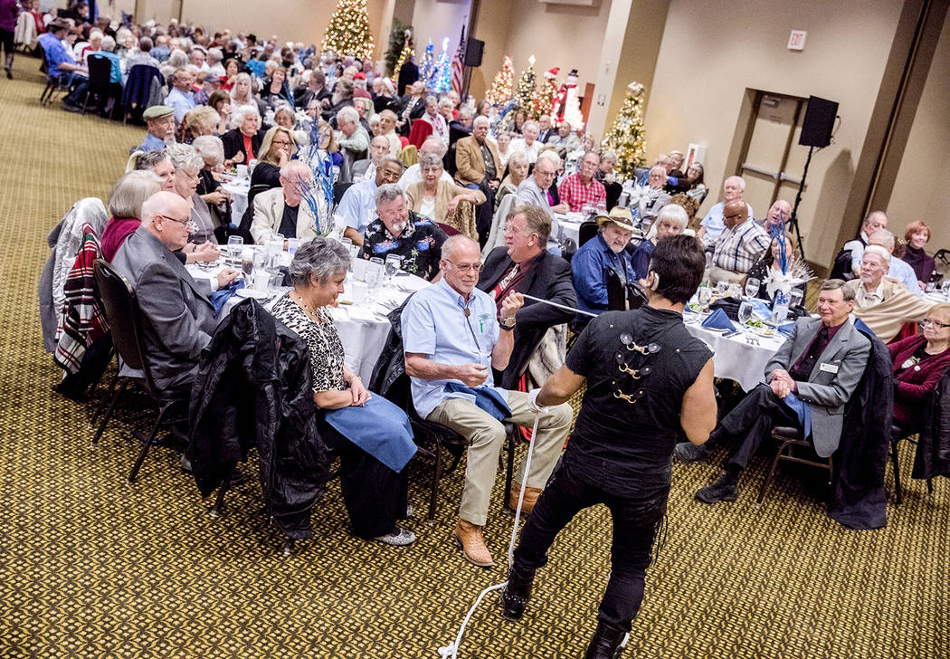Special to the Pahrump Valley Times Entertainer and magician, Olly, entertains the crowd of more than 200 ambassadors at the 2017 Ambassador Christmas dinner and awards banquet at the Pahrump Nugg ...