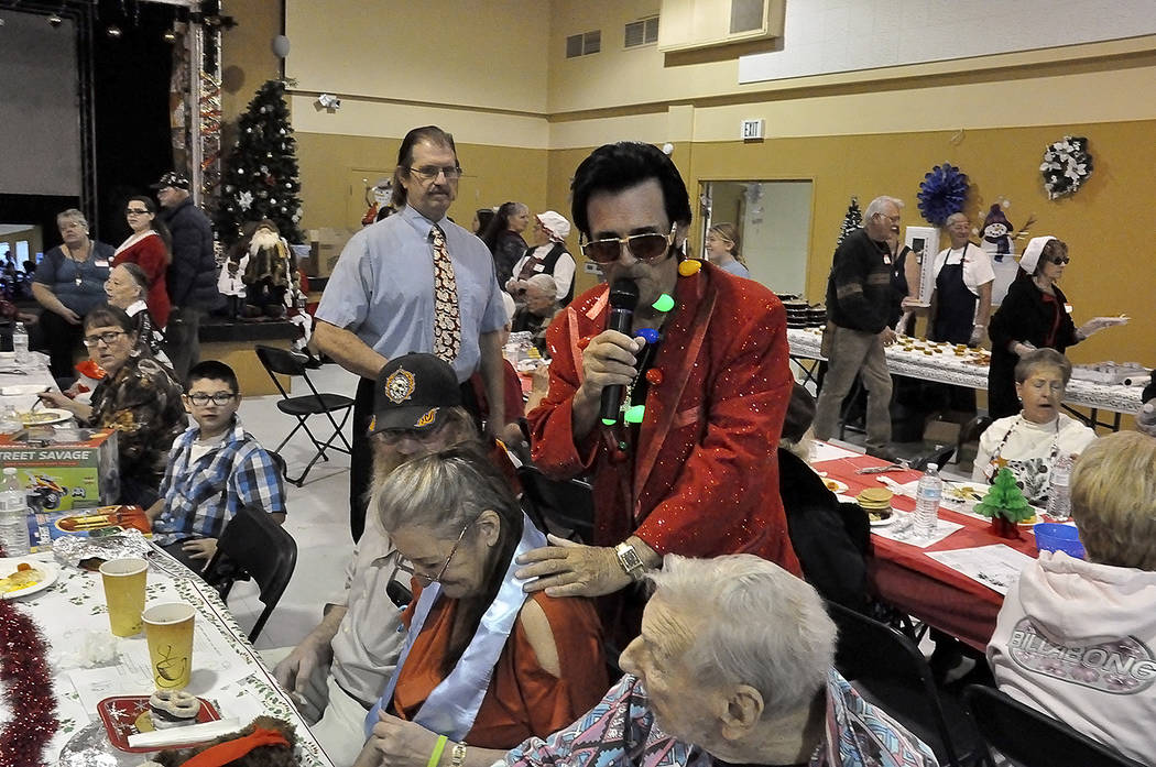 Horace Langford Jr./Pahrump Valley Times Pahrump's own Elvis Presley impersonator Johnny V entertains attendees during NyE Communities Coalition's Christmas Day Brunch on Monday. The event is host ...