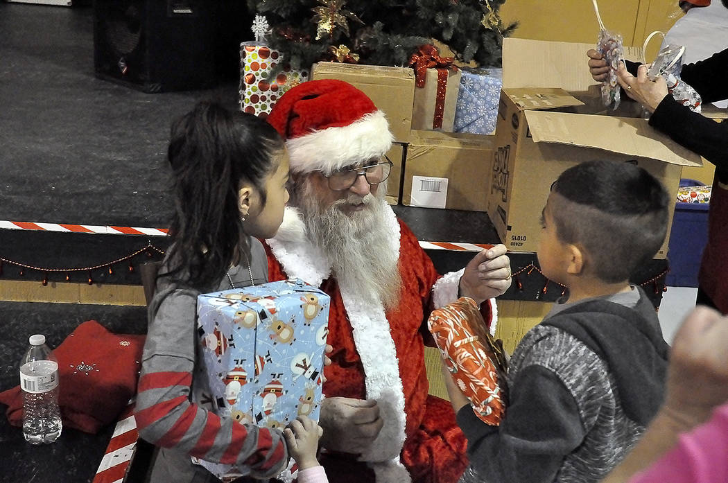 Horace Langford Jr./Pahrump Valley Times Following a very long and busy Christmas Day, Santa Claus still had the time, energy and presents to make a special appearance at the Holiday Task Force's  ...