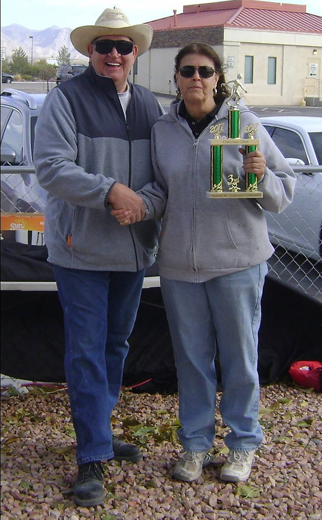 Special to the Pahrump Valley Times Dennis Andersen is shown presenting a trophy to Char Schulte of Las Vegas. She earned first-place honors in C the division of the horsehsoe tournament held Dec. ...