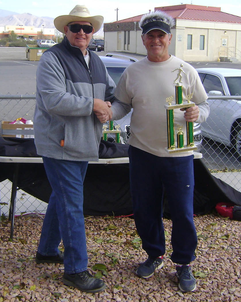 Special to the Pahrump Valley Times Dennis Andersen is shown presenting a trophy to Mike Nicosia, who was among the first-place winners in Pahrump on Dec. 16 when a horseshoe tournament was held.