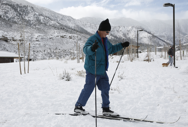 David Guzman/Las Vegas Review-Journal What a difference a year makes. This photo from late December 2016 shows a skier outside the Spring Mountains Visitor Gateway. The Spring Mountains National R ...
