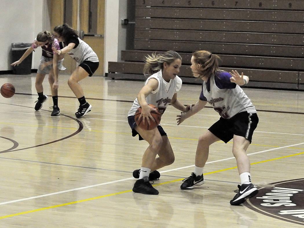Horace Langford Jr./Pahrump Valley Times Samantha Runnion and Makayla Gent of the girls basketball team at Pahrump Valley High School are seen practicing earlier this season.The Lady Trojans next  ...