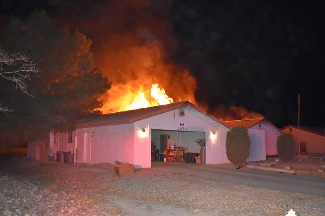 Special to the Pahrump Valley Times  Pahrump Fire Chief Scott Lewis said fire crews responded multiple times to a structure fire along the 2600 block of South Dandelion Street on Monday evening Ja ...