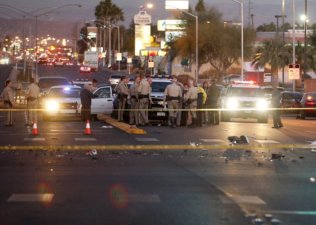 K.M. Cannon/Las Vegas Review-Journal  Las Vegas police are shown at a multiple-vehicle crash that left three people dead Wednesday, Dec. 13, 2017. Preliminary data shows that 303 traffic fatalitie ...