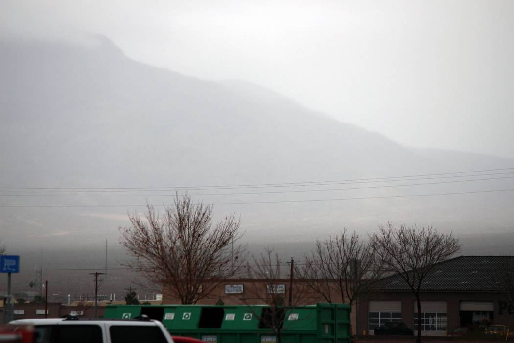 Jeffrey Meehan/Pahrump Valley Times Clouds set in across the mountain landscape to the north of the Pahrump Walmart on Jan. 9, 2017. Measurable rainfall hadn't landed in the valley for 116 days, b ...