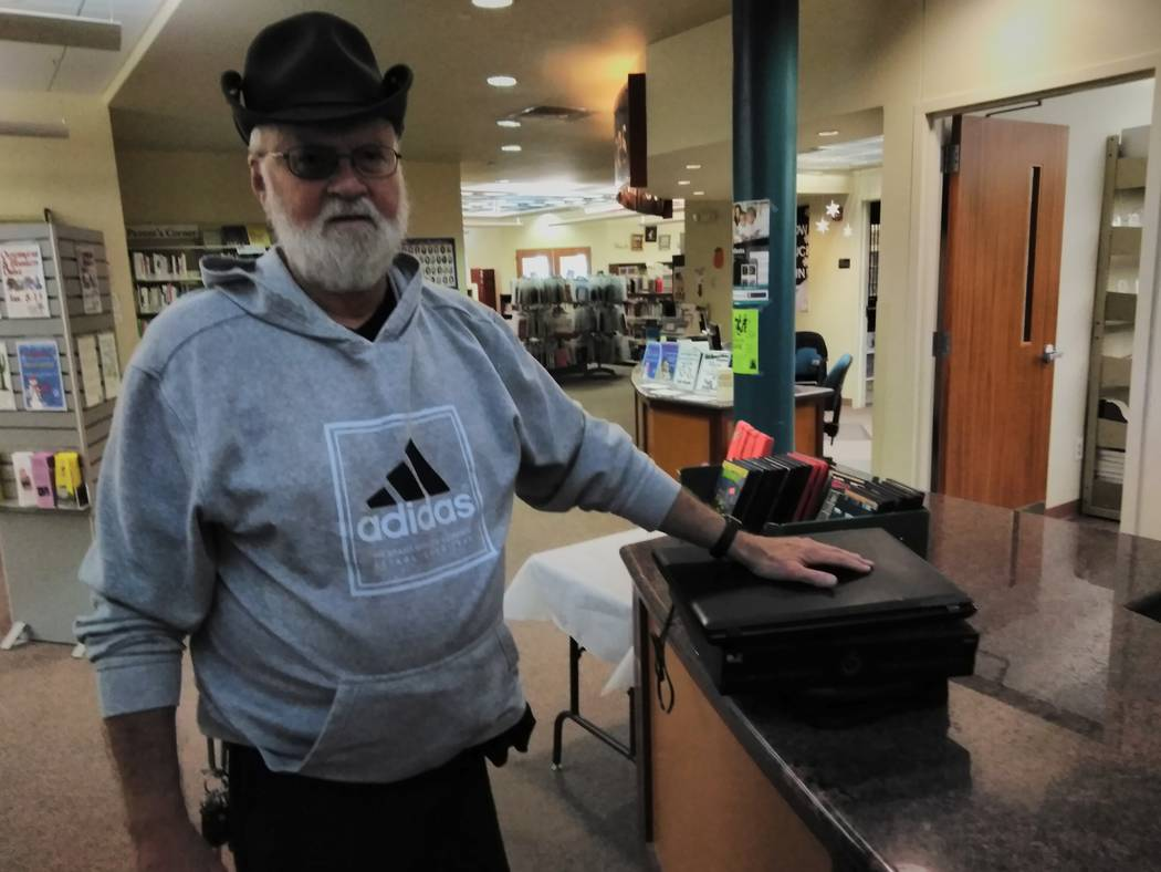 """Selwyn Harris/Pahrump Valley Times Local resident Gil Knappmiller turned in several electrical devices including a converter box and several old computers during the Pahrump Community Library's """"E ..."""