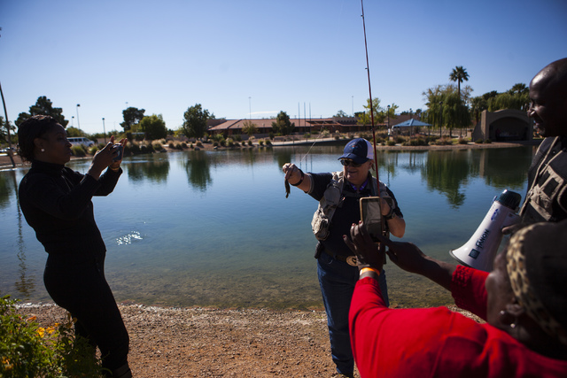 Miranda Alam/Las Vegas Review-Journal  Ivy Santee, Angler education coordinator of Southern Nevada for the Department of Wildlife, holds up the fish caught by Emma Barlow, bottom right, during a s ...