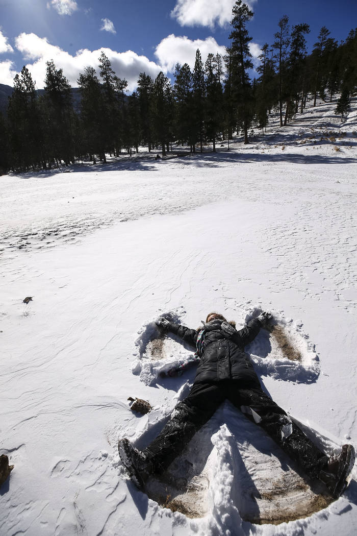 Richard Brian/Las Vegas Review-Journal  Jenna Leinecke, 11, of Indian Springs makes a snow angel while playing with her family at Lee Canyon's Upper Meadow on Mount Charleston on Thursday, Dec. 21 ...