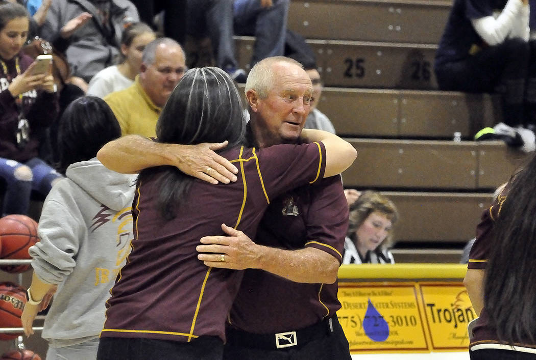 Horace Langford Jr./Pahrump Valley Times  Pahrump Valley girls basketball Coach Bob Hopkins receives hug in celebrating his 500th win on Monday night. In 2016, Hopkins returned to the basketball c ...