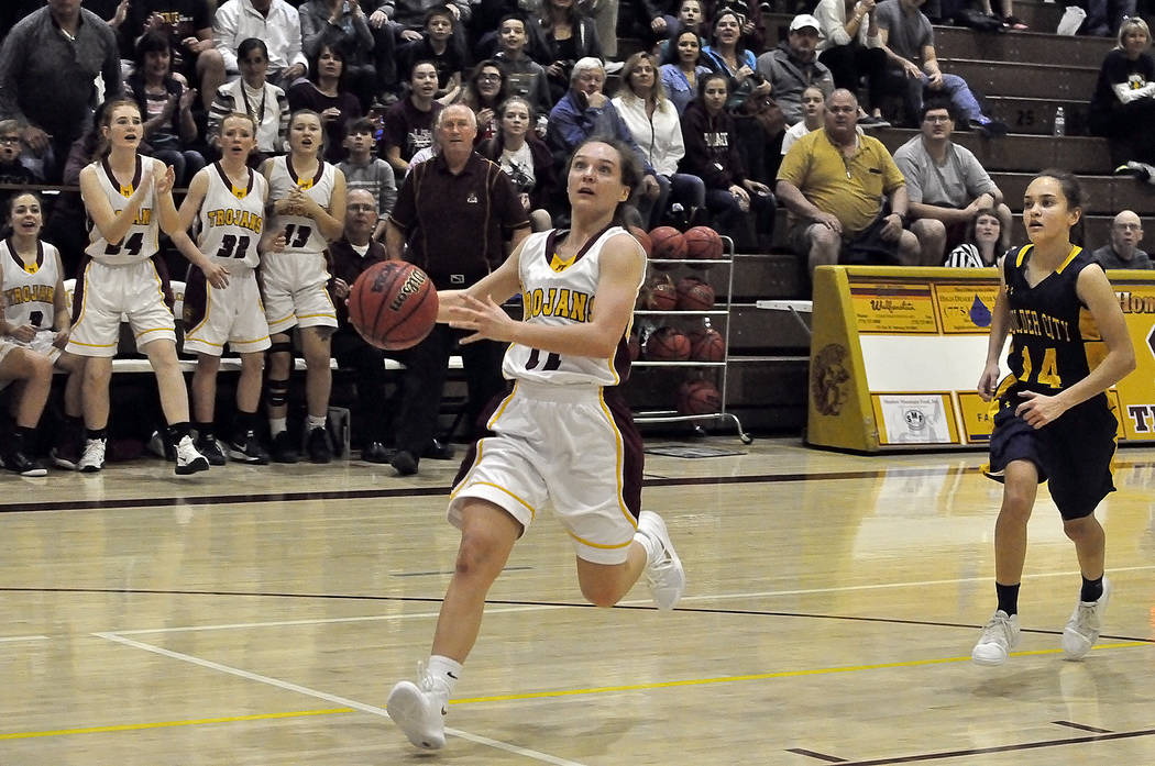 Horace Langford Jr./Pahrump Valley Times  Pahrump Valley's Jaquellen Stobbe heads down the court in Pahrump Valley's win over Boulder City on Monday night. The win marked the 500th for Trojans Coa ...