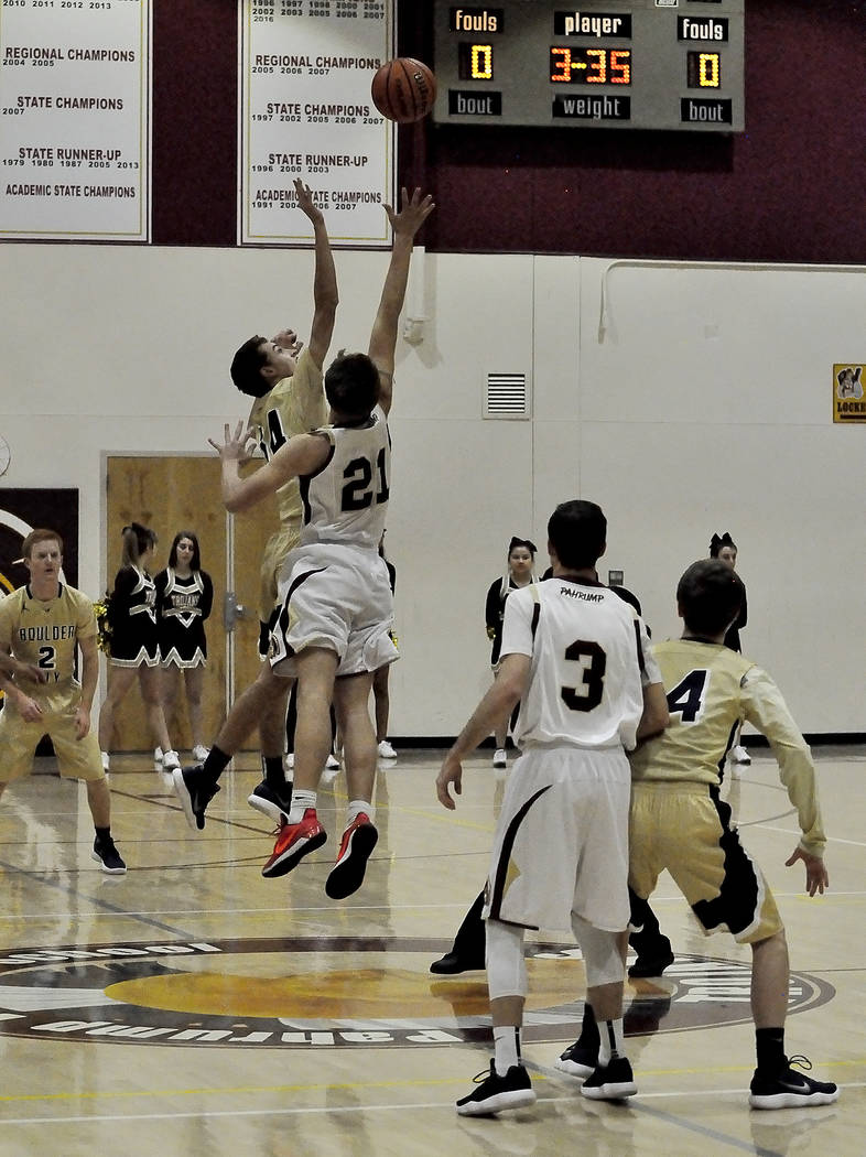 Horace Langford Jr./Pahrump Valley Times Pahrump Valley's Brayden Severt tips off against Boulder City this week. His team was defeated by Boulder City but rebounded to defeat the Sunrise Miners o ...