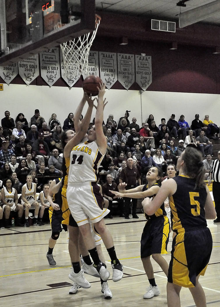 Horace Langford Jr./Pahrump Valley Times Pahrump Valley's Kylie Stritenberger (in white uniform) is shown playing against Boulder City this week.  She had 12 points in that game. The Trojans are a ...
