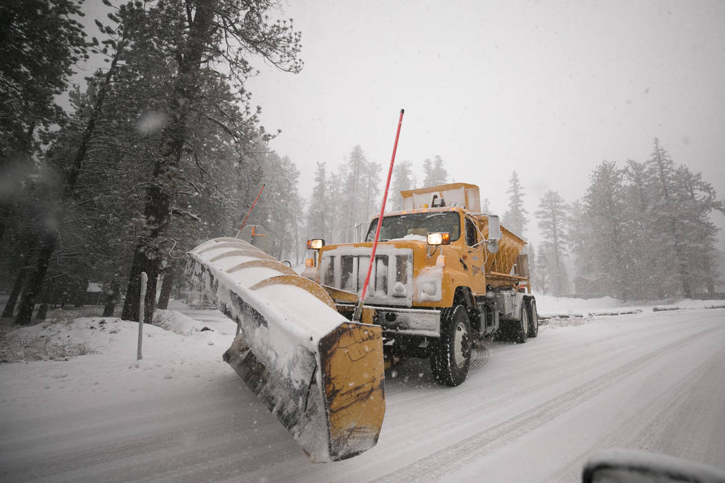 Richard Brian/Las Vegas Review-Journal A snow plow clears the roads at Upper Lee Meadows in Lee Canyon outside of Las Vegas, Tuesday, Jan. 9, 2018. The snow prompted a winter storm warning.