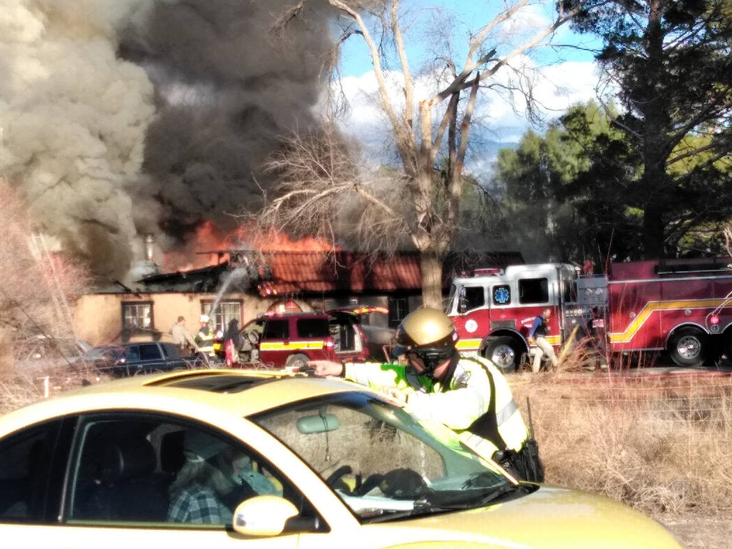 Selwyn Harris/Pahrump Valley Times  Nye County Sheriff's Office deputies were forced to re-route motorists driving along the 2000 block of Manse Road, as fire crews worked to extinguish the Wedn ...