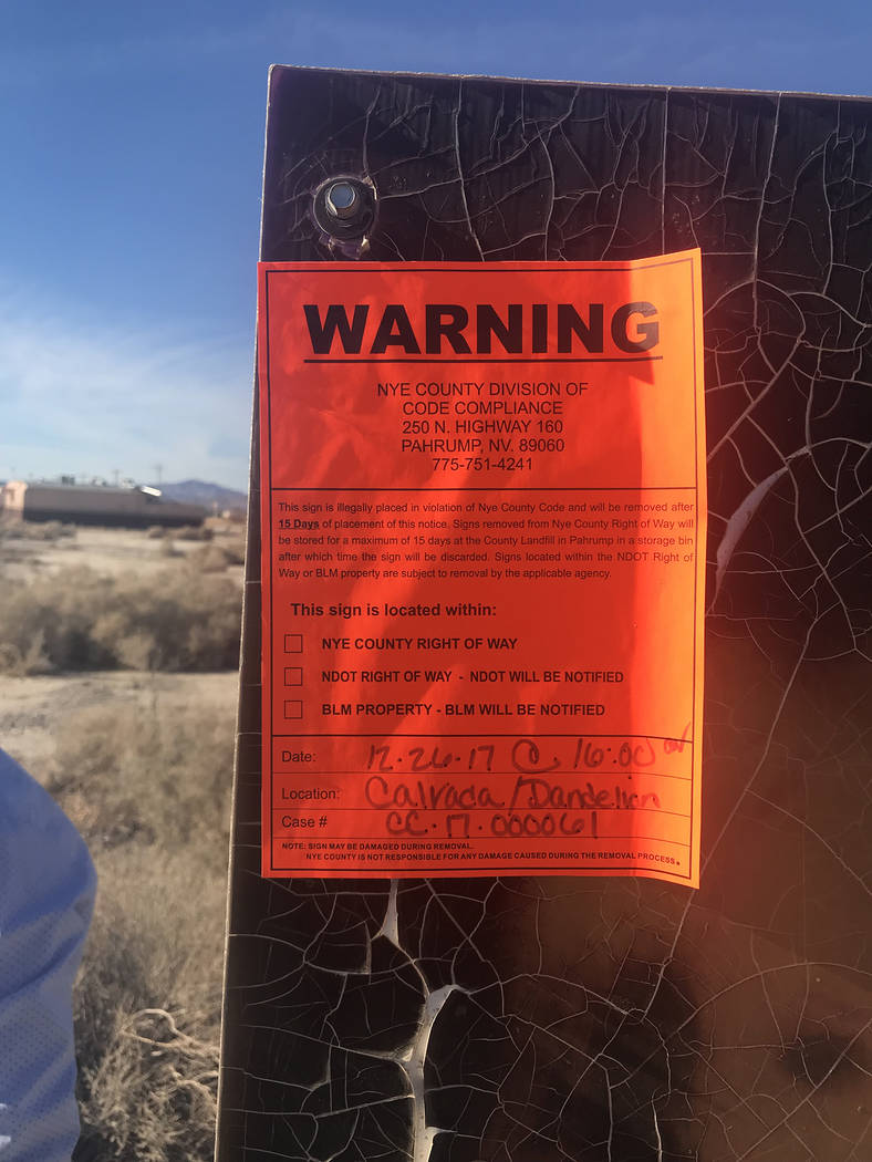 Warning signs are going up on illegally placed signs in Pahrump. The county is taking action to address signage that does not conform to Nye County Code. Special to the Pahrump Valley Times