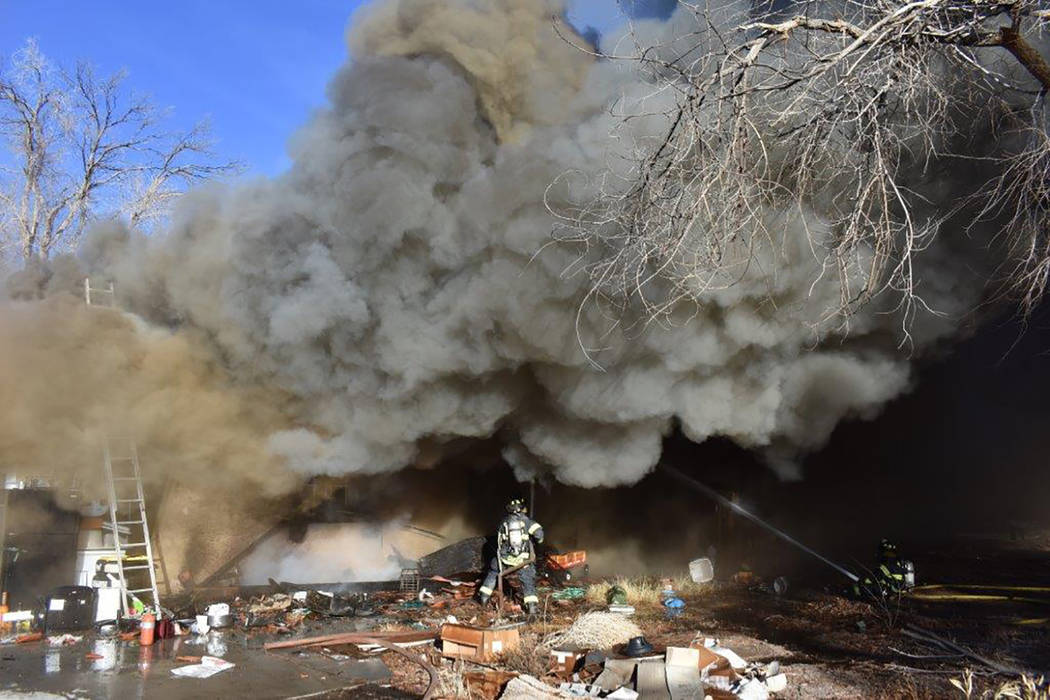 Special to the Pahrump Valley Times  The sheer size of the fire dwarfs firefighters attempting to extinguish the structure fire on Monday afternoon Jan. 10. No serious injuries were reported but t ...
