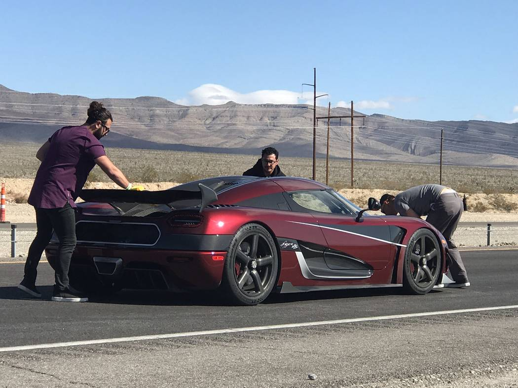 Jeffrey Meehan/Pahrump Valley Times The record-breaking Koenigsegg Agera RS is readied for another run along an 11-mile stretch on Highway 160 on Nov. 4, between the Tecopa turnoff and Spring Moun ...