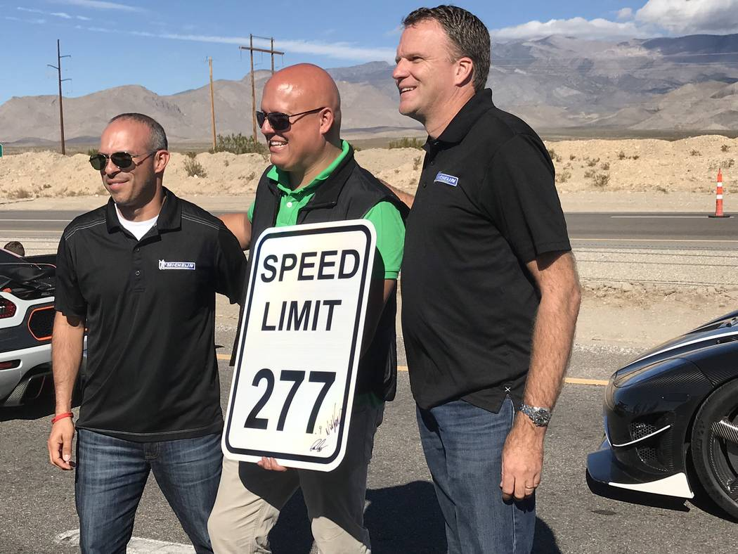 Jeffrey Meehan/Pahrump Valley Times Christian von Koenigsegg (center), CEO and founder of Koenigsegg, a Swedish car maker, stands with two unidentified Michelin representatives at his company's re ...