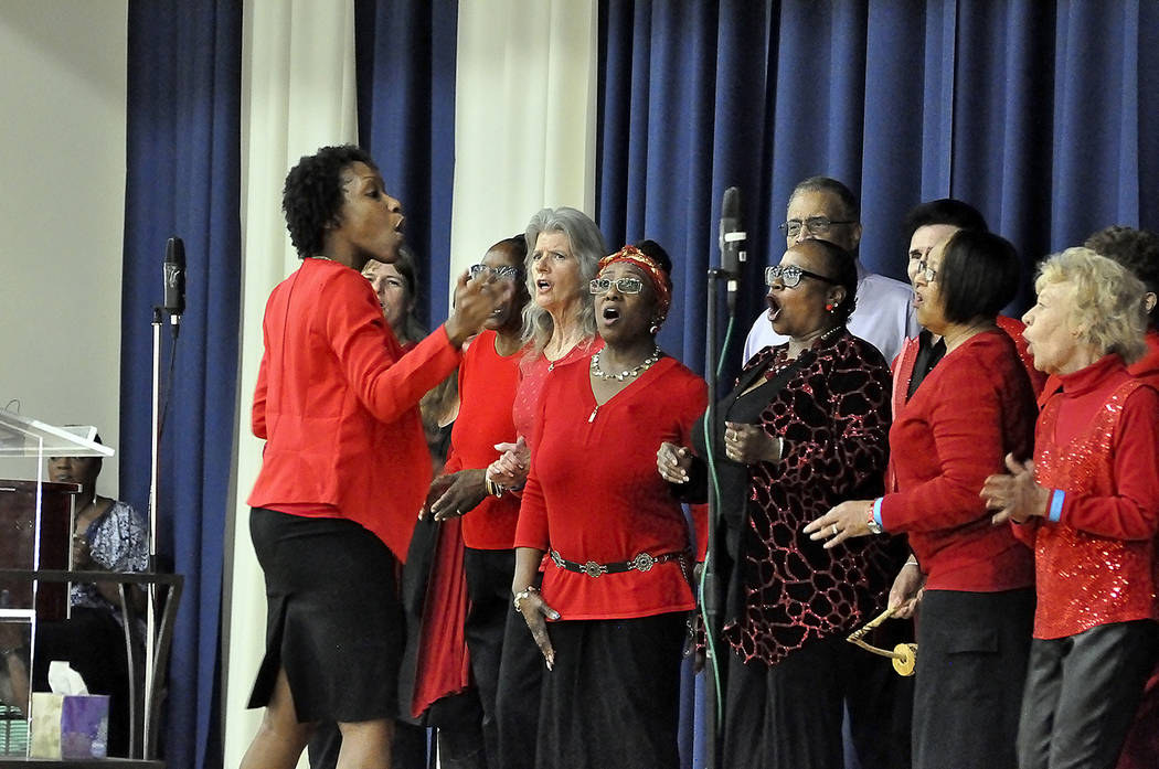 """Horace Langford Jr./Pahrump Valley Times Members of Pahrump's MLK Community Singers provided the gift of song throughout the Monday morning service. The group, performing the song """"Bind us Togethe ..."""