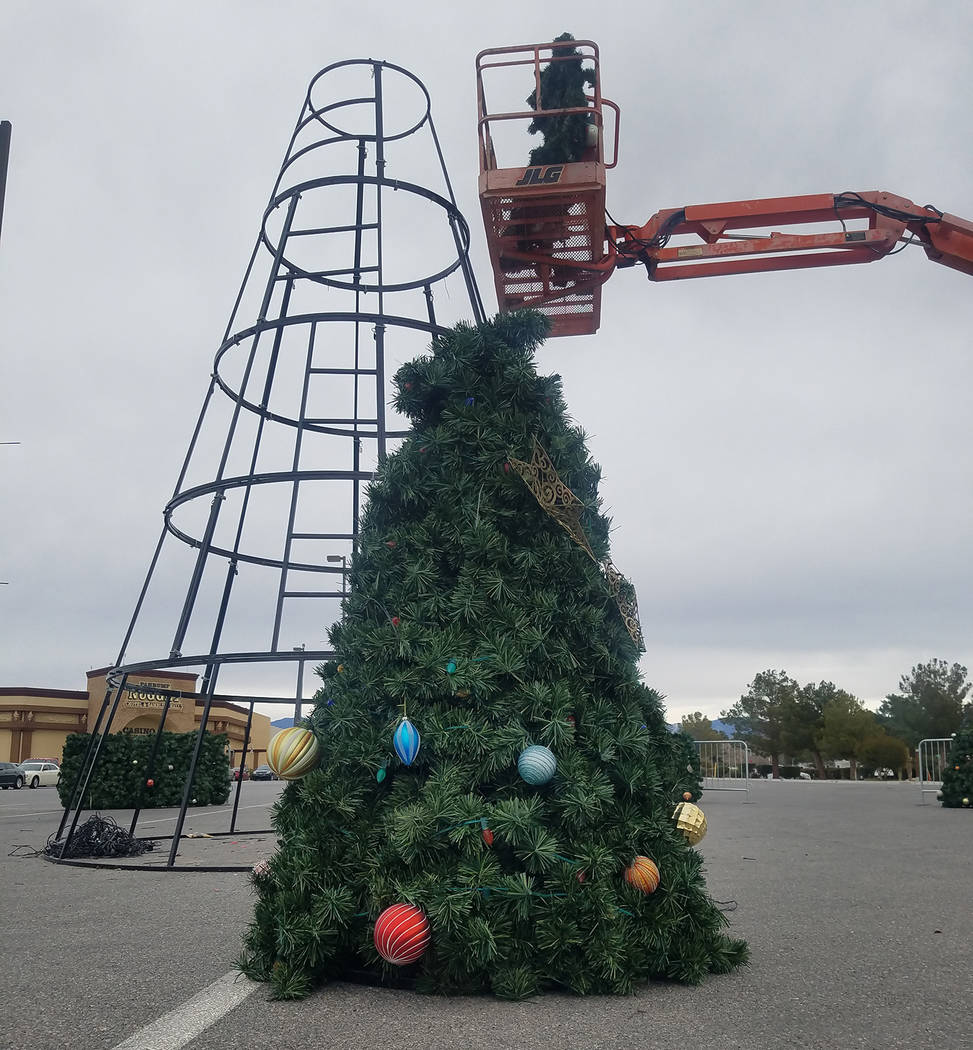 David Jacobs/Pahrump Valley Times The community's Christmas tree was taken down in Pahrump on Tuesday outside the Pahrump Nugget hotel-casino. The official tree-lighting ceremony took place after  ...