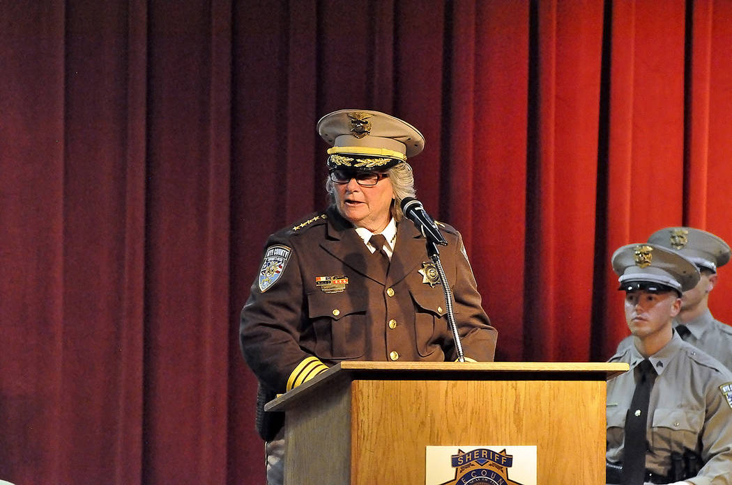 Horace Langford Jr./Pahrump Valley Times Nye County Sheriff Sharon Wehrly addresses the attendees during Saturday's Sheriff's office graduation ceremony at Pahrump Valley High School. Wehrly spoke ...