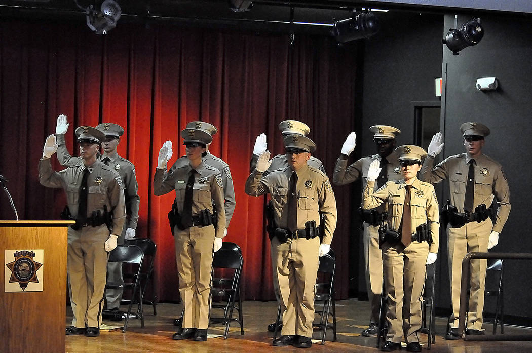 Horace Langford Jr./Pahrump Valley Times Nine Nye County County Sheriff's Office recruits stand tall as they are administered their law enforcement oath by Sheriff Sharon Wehrly. 14 sheriff's offi ...
