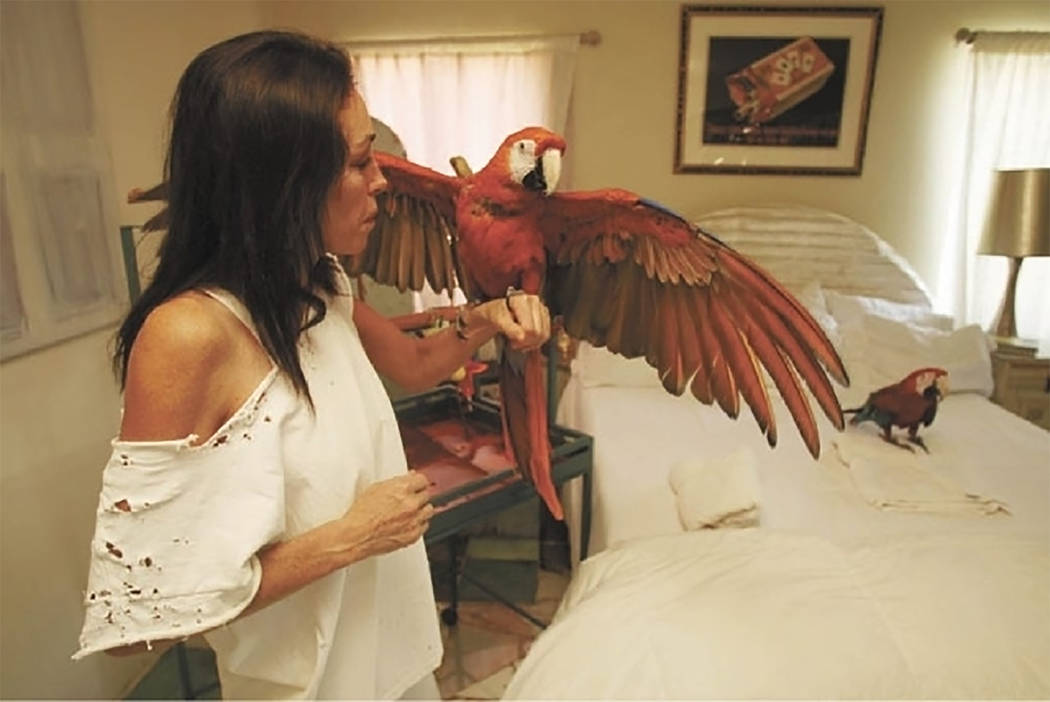 Special to the Pahrump Valley Times Pahrump resident Heidi Fleiss, pictured with two of her more than two dozen pet birds is working to establish a future exotic bird sanctuary in town for all var ...