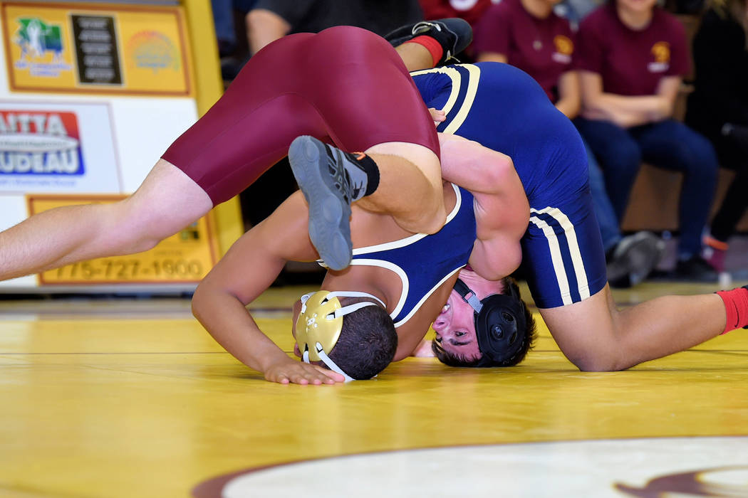 Peter Davis/Special to the Pahrump Valley Times Pahrump Valley's Tristan Maughan pins a Cheyenne wrestler this season. Earlier this week, the Trojans faced Sunrise Mountain and Western at Sunrise  ...