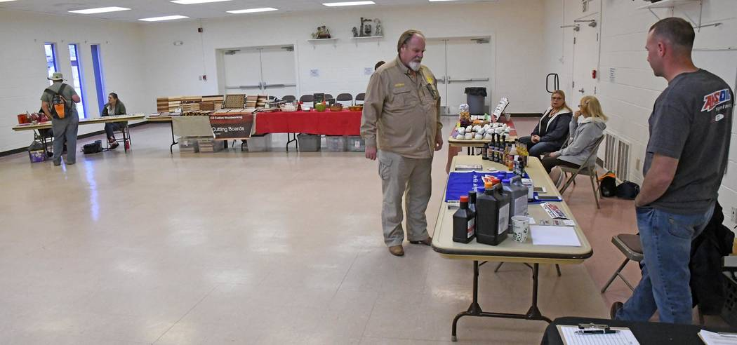 Richard Stephens/Special to the Pahrump Times Kameron Harris, left, was one of the vendors selling his handcrafted cigar boxes at the Beatty craft show. The Nye County Nevada Chamber of Commerce p ...