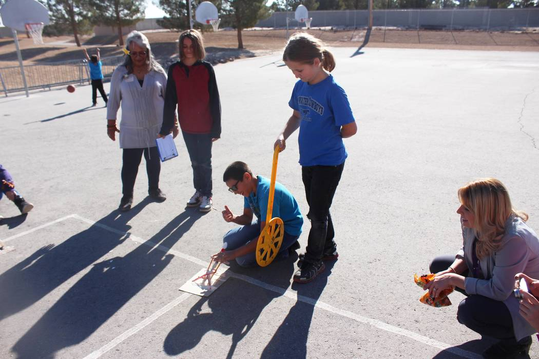 Jeffrey Meehan/Pahrump Valley Times Katrina Dietrich (right) takes her fifth grade class at Floyd Elementary School outside to conduct scientific experiments on Dec. 14, 2017. Floyd Elementary has ...