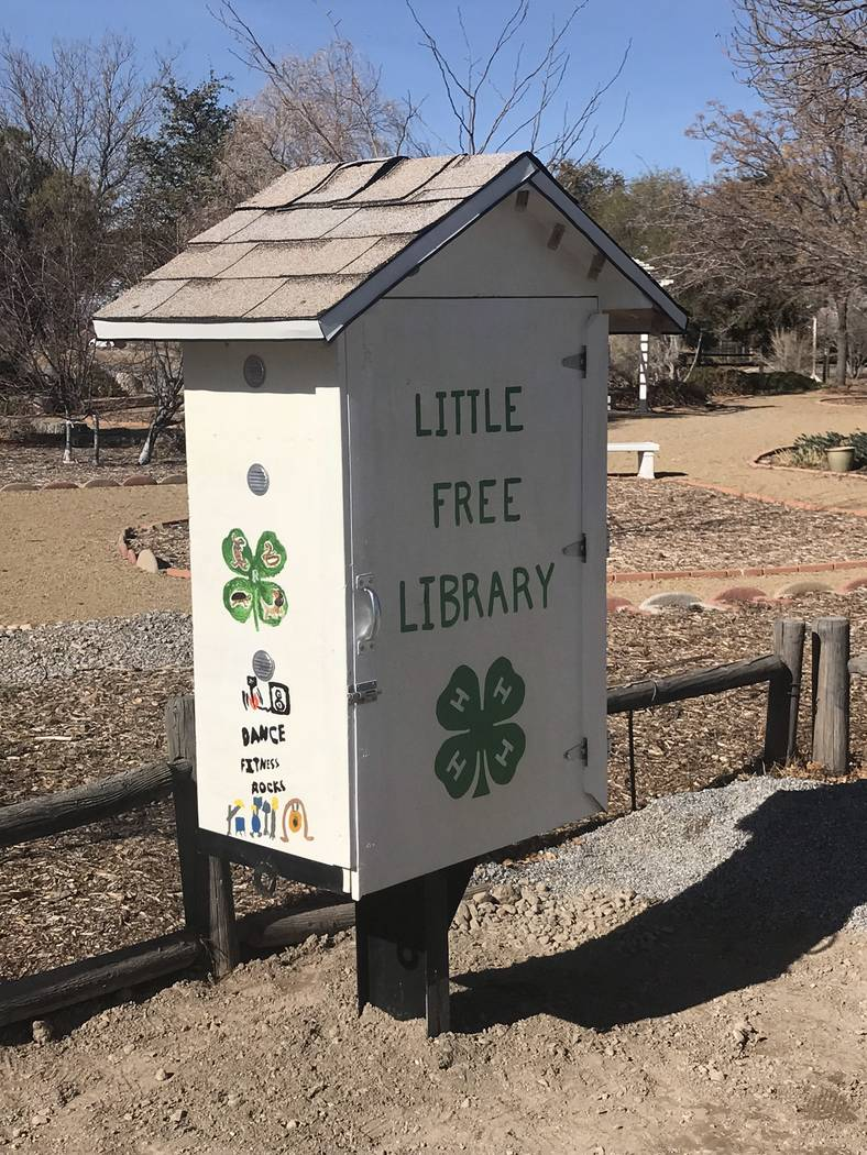 Jeffrey Meehan/Pahrump Valley Times Pahrump 4-H officially opened its Little Free Library on Jan. 15, 2018. The exchange-driven library contains several fiction and nonfiction titles to choose fro ...