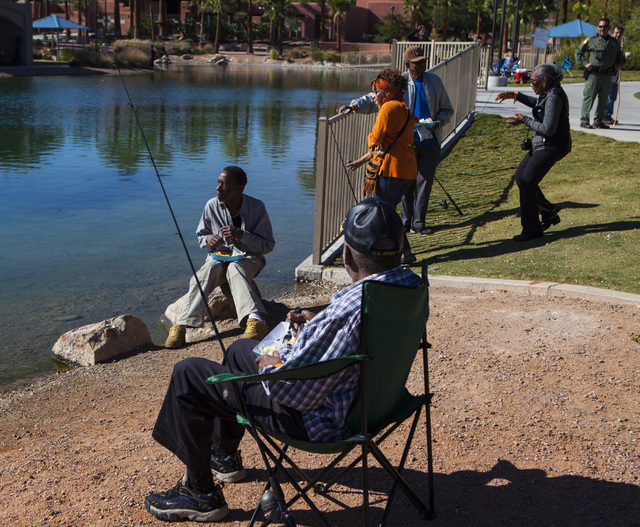 Miranda Alam/Las Vegas Review-Journal  Attendees fish during a senior fishing derby in 2016 in Southern Nevada. Fishing is available in multiple spots around the region.