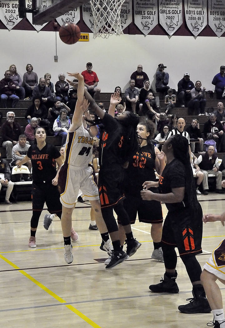 Horace Langford Jr./Pahrump Valley Times  Pahrump Valley's win on Wednesday against Desert Pines improved the Trojans record to 12-3 on the season. Savannah Fairbank of the Pahrump Valley Trojans  ...