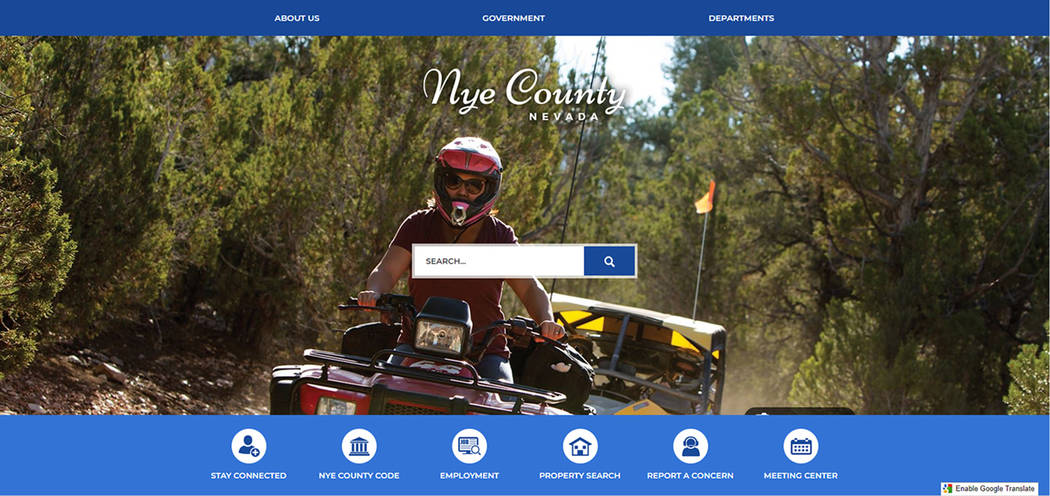Screenshot The new government website greets visitors with a main page displaying various photos taken around the Nye County.