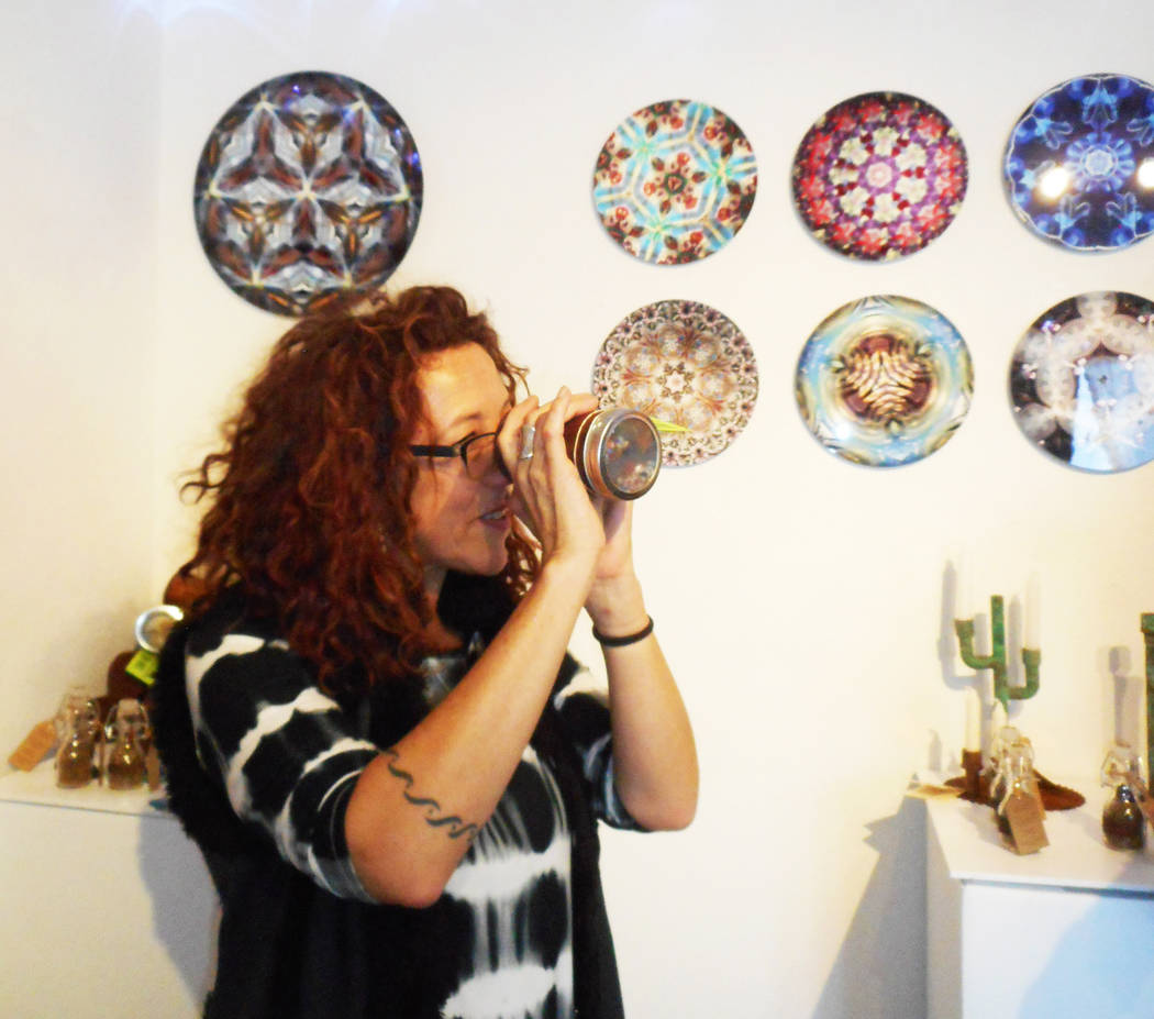 Robin Flinchum/Special to the Pahrump Valley Times Artist Judyth Greenburgh demonstrating one of her kaleidoscopes at the Tecopa Artists Group Gallery. Later this month is the Tecopa/Shoshone arts ...